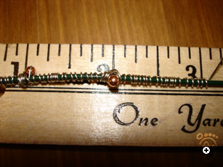 wrap wire around second bead